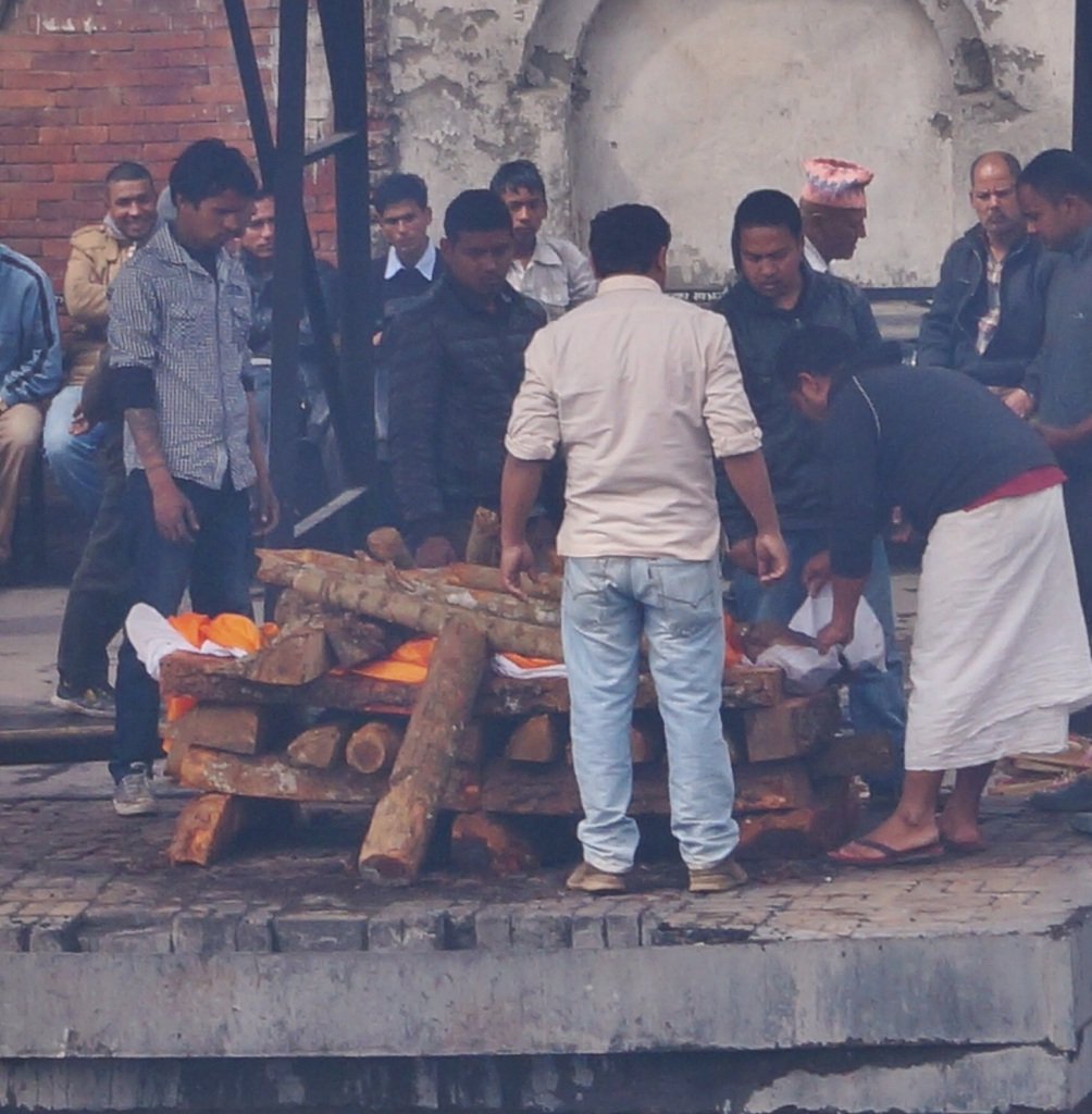 I took this picture from across the river bank. At the time, I could not see the body on the pyre and assumed that the men were merely preparing for the cremation. It was only when I uploaded the photo's to my computer that I realised I had inadvertently taken a picture of a dead man with his family.